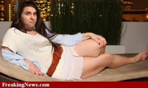 Man-in-Drag-Lying-on-Couch---74636